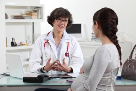 беременная женщина на консультации врача